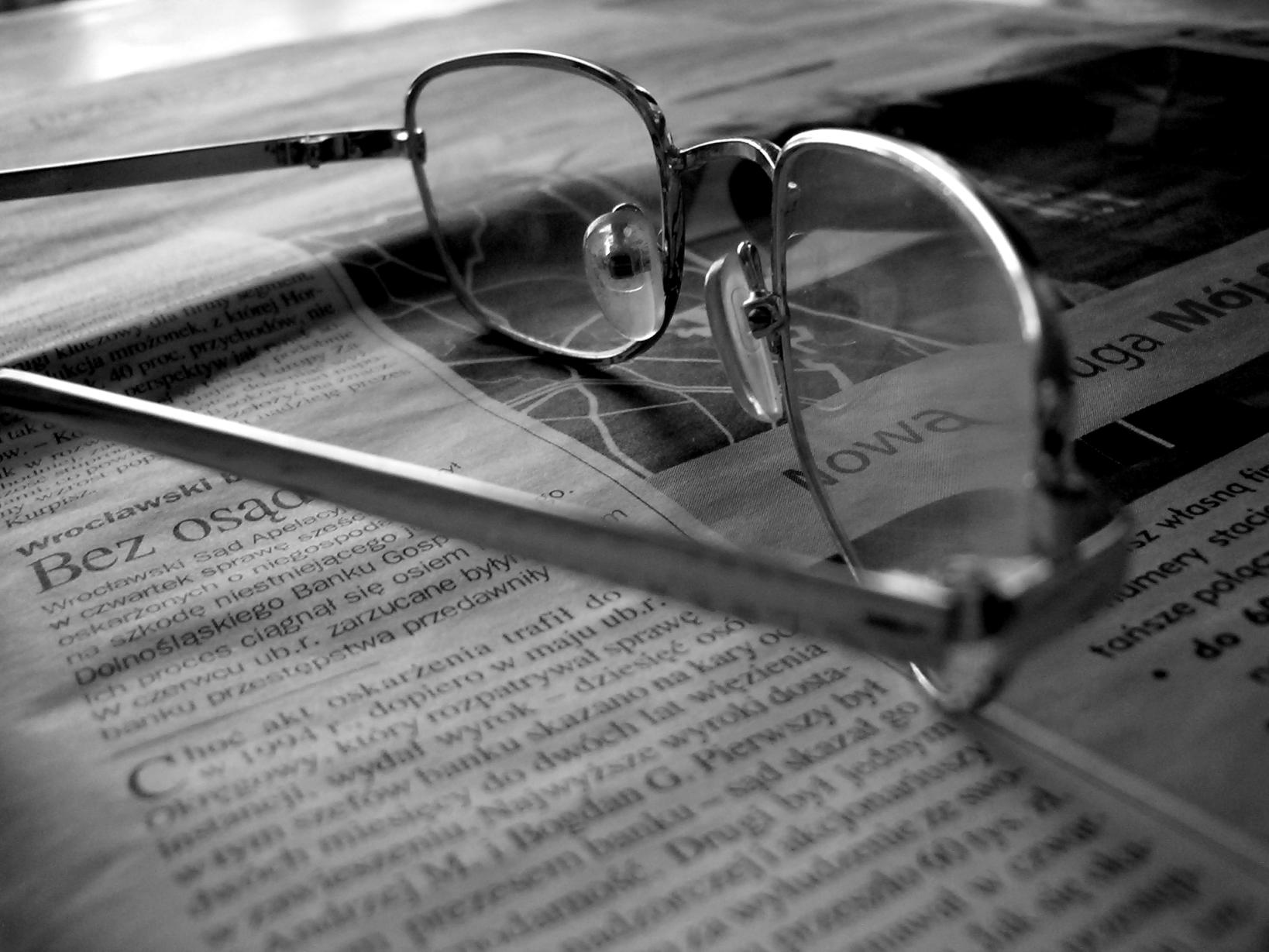 glasses-on-the-newspaper-1-1427945